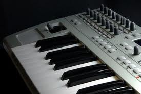A MIDI keyboard connects to a computer for recording music.